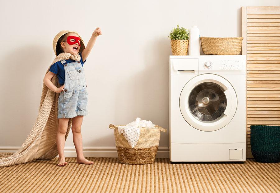 Happy kid doing laundry