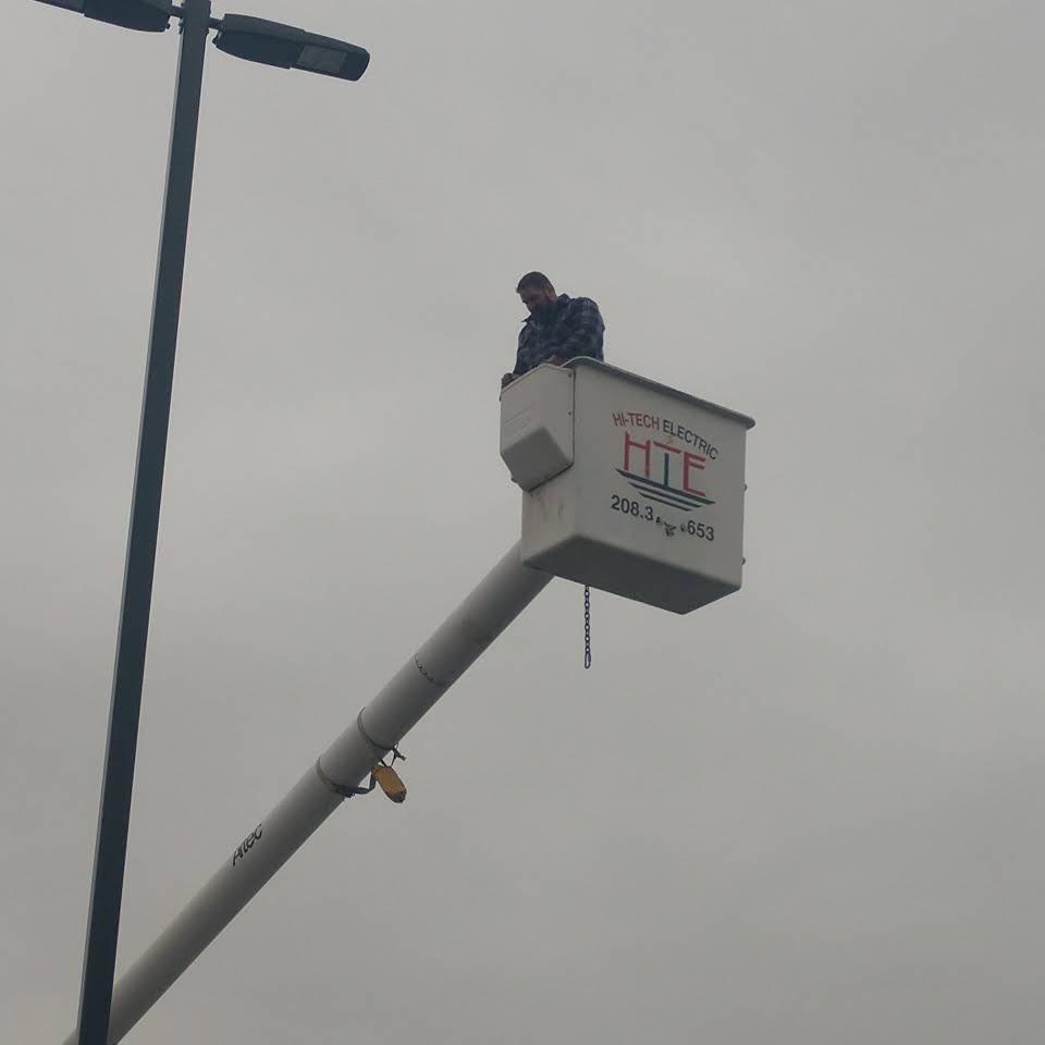 Justin, owner of HiTech Electric, in a bucket truck